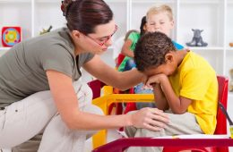 teacher-comforting-crying-boy-picture-id152140326